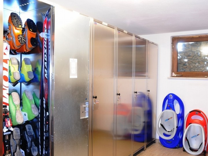 Large ski room equipped with heated boot warmers for drying and warming of boots.