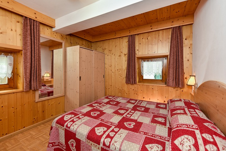 Room with doublebed + third bed. Wardrobe and bedside tables.