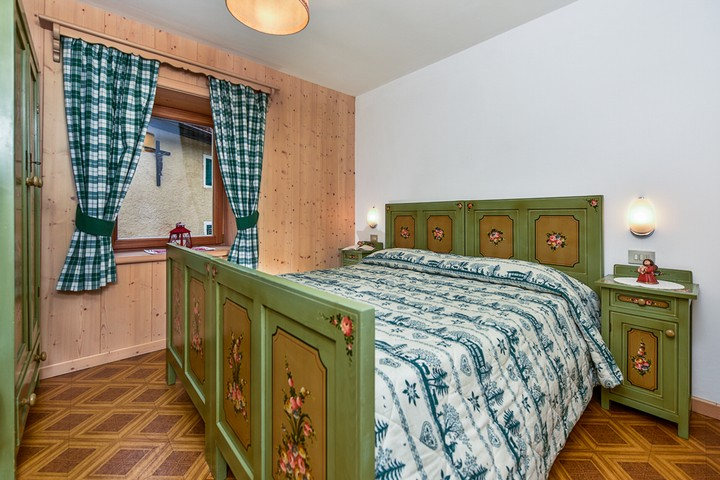 Room with doublebed. Wardrobe and bedside tables.