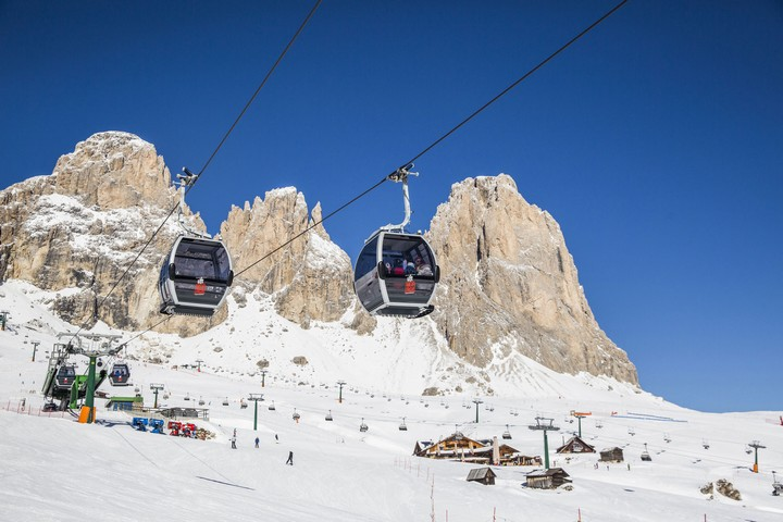 Ski lifts and slopes Col Rodella Campitello di Fassa. Panorama towards Sassolungo Group