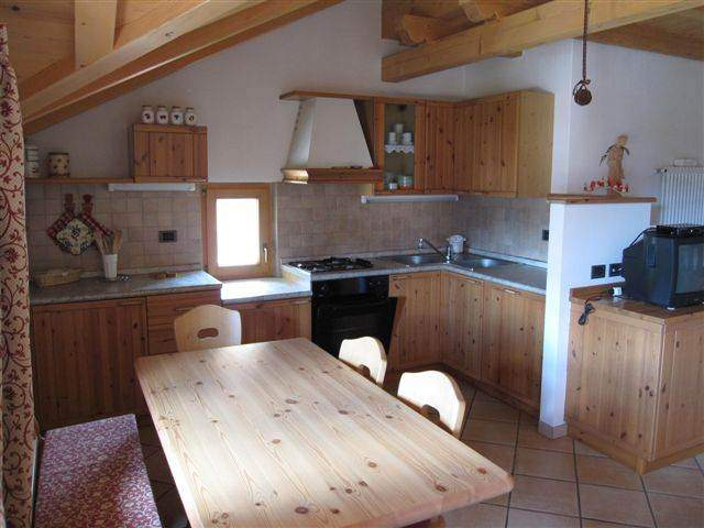 kitchen in the living room (mansard)with refined details. A big table for quite lunches and charming dinners with friends