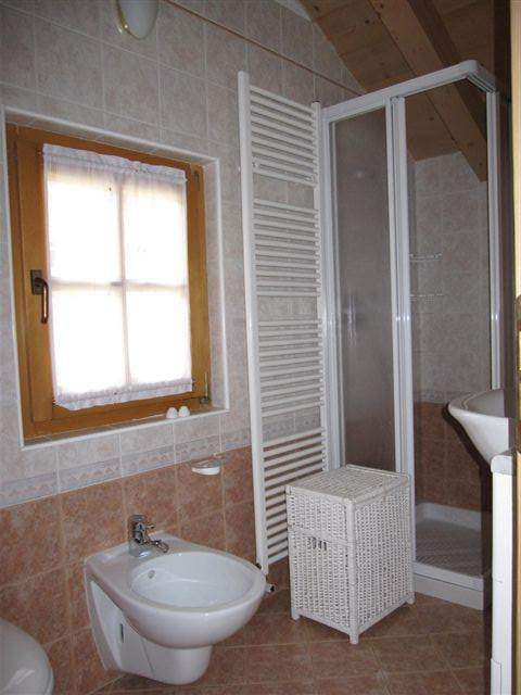 one of the two bathrooms with shower and window. plain but also refined style