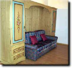 tipical of our flats with furniture hand painted, to sit down and have a conversation or watch TV or to repose