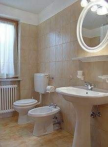 Bathroom with bath-tub, shower and washing machine